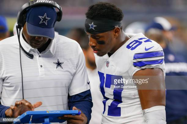 Dallas Cowboys defensive end Taco Charlton works with a coach during the NFL preseason game between the Indianapolis Colts and Dallas Cowboys at ATT...