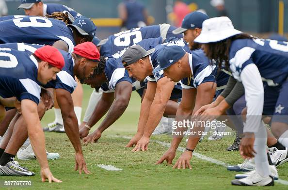 Dallas Cowboys defensive players line up during the walkthrough at the team's training camp in Oxnard Calif on Tuesday Aug 9 2016