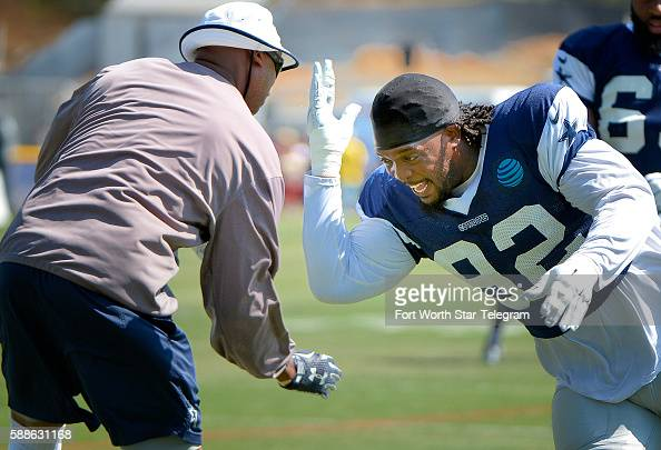 Dallas Cowboys defensive tackle Cedric Thornton takes on defensive tackles coach Leon Lett during the morning practice at the team's training camp in...