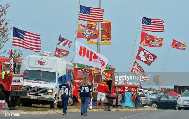Dallas Cowboys' fans walk along the parking lot where Kansas City Chiefs' fans are tailgating at Arrowhead Stadium in Kansas City Missouri on Sunday...