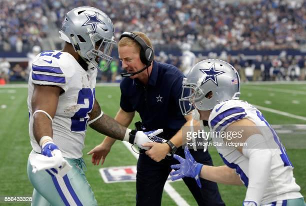Dallas Cowboys head coach Jason Garrett and receiver Ryan Switzer congratulate running back Ezekiel Elliott after he scored a touchdown against the...