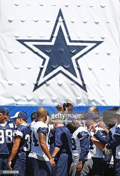 Dallas Cowboys head coach Jason Garrett gathers with his players following a morning walkthrough practice during Dallas Cowboys Summer Training Camp...