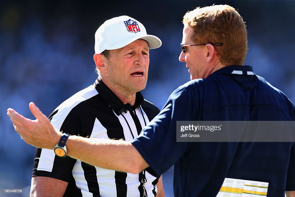 Dallas Cowboys head coach <a gi-track='captionPersonalityLinkClicked' href=/galleries/search?phrase=Jason+Garrett&family=editorial&specificpeople=965512 ng-click='$event.stopPropagation()'>Jason Garrett</a> questions a call with referee <a gi-track='captionPersonalityLinkClicked' href=/galleries/search?phrase=Ed+Hochuli&family=editorial&specificpeople=2091125 ng-click='$event.stopPropagation()'>Ed Hochuli</a> in the second half against the San Diego Chargers at Qualcomm Stadium on September 29, 2013 in San Diego, California. The Chargers defeated the Cowboys 30-21.