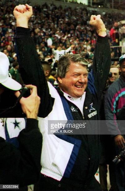 Dallas Cowboys head coach Jimmy Johnson celebrates his team's win over the San Francisco 49ers during the last seconds of the game 23 January 1994...