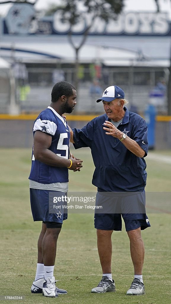 Dallas Cowboys inside linebacker Bruce Carter and defensive coordinator Monte Kiffin after the team's training camp walkthrough on Friday August 2 in...