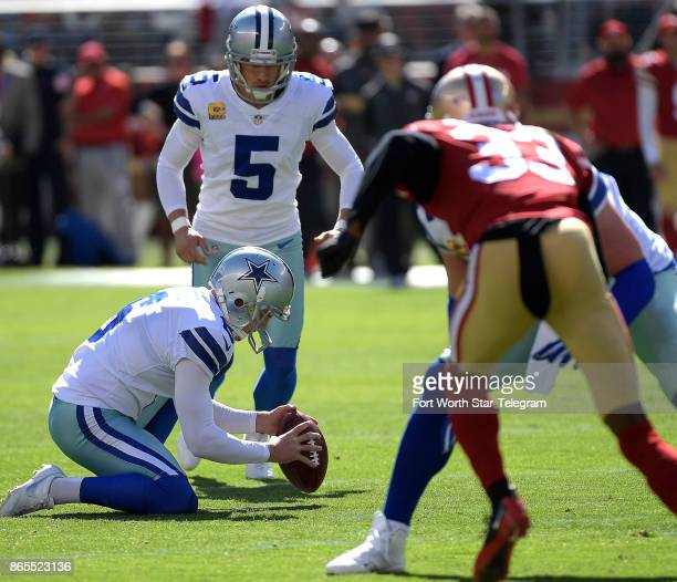 Dallas Cowboys kicker Dan Bailey kicks the point after touchdown with punter Chris Jones holding during the first quarter against the San Francisco...