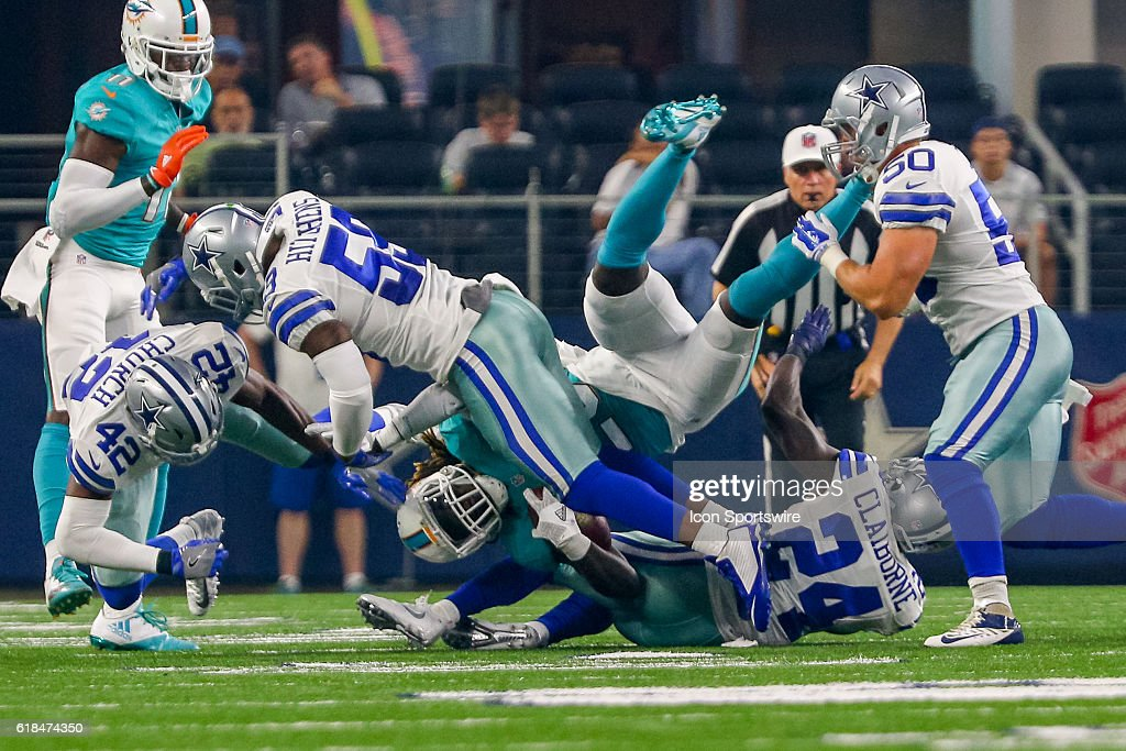 7eb38685430 ... Olive Mens Jersey 2017 Salute to Service Limited Nike Dallas Cowboys  middle linebacker Anthony Hitchens (59) hits Miami Dolphins running back  Jay Ajayi ...
