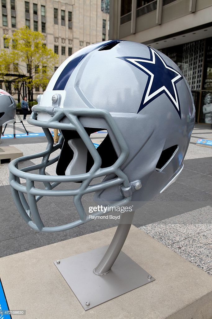 Dallas Cowboys NFL football helmet is on display in Pioneer Court to commemorate the NFL Draft 2015 in Chicago on April 30 2015 in Chicago Illinois