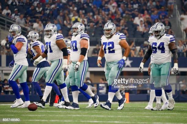 Dallas Cowboys offensive linemen approach the line of scrimmage during the NFL preseason game between the Indianapolis Colts and Dallas Cowboys at...