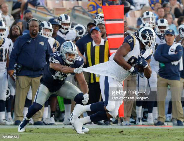 Dallas Cowboys outside linebacker Kyle Wilber grabs Los Angeles Rams tight end Gerald Everett by the jersey to bring him down on a pass completion...