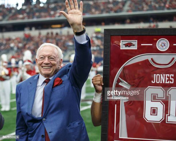 Dallas Cowboys owner and Arkansas Razorbacks alum Jerry Jones acknowledges the crowd during a halftime presentation during the college football game...