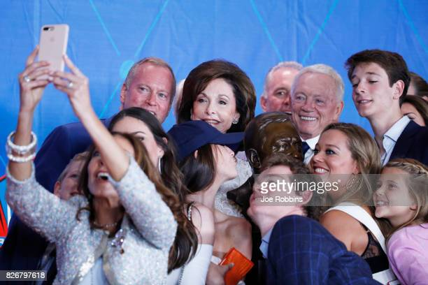 Dallas Cowboys owner Jerry Jones and his family take a selfie with his bust during the Pro Football Hall of Fame Enshrinement Ceremony at Tom Benson...