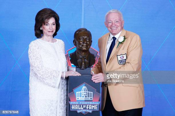 Dallas Cowboys owner Jerry Jones and wife Gene Jones pose with his bust during the Pro Football Hall of Fame Enshrinement Ceremony at Tom Benson Hall...