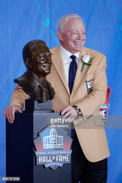 Dallas Cowboys owner Jerry Jones poses with his bust during the Pro Football Hall of Fame Enshrinement Ceremony at Tom Benson Hall of Fame Stadium on...