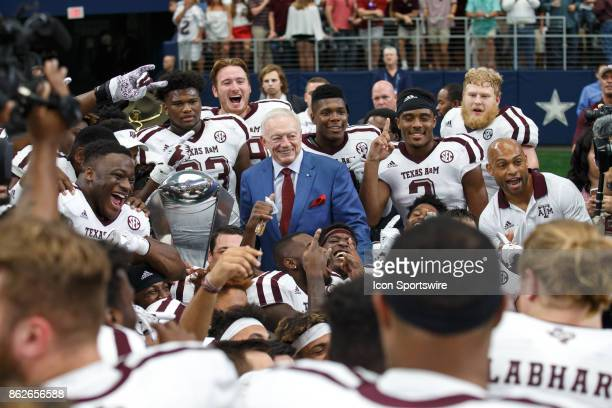 Dallas Cowboys owner Jerry Jones presents the Southwest Classic trophy to the Texas AM Aggies during the college football game between the Arkansas...