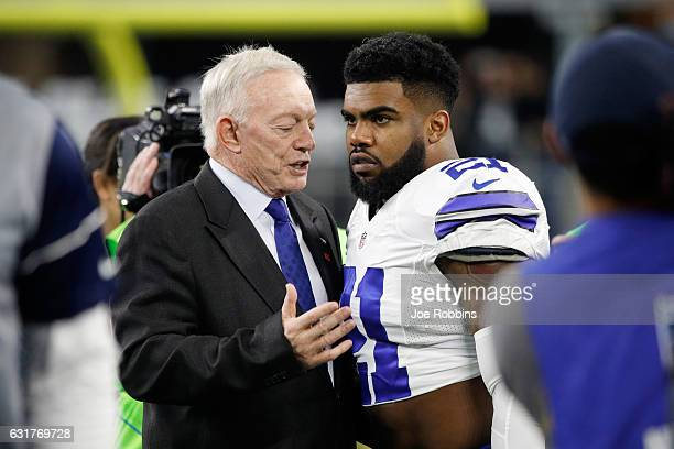Dallas Cowboys owner Jerry Jones talks with Ezekiel Elliott of the Dallas Cowboys before the NFC Divisional Playoff Game against the Green Bay...