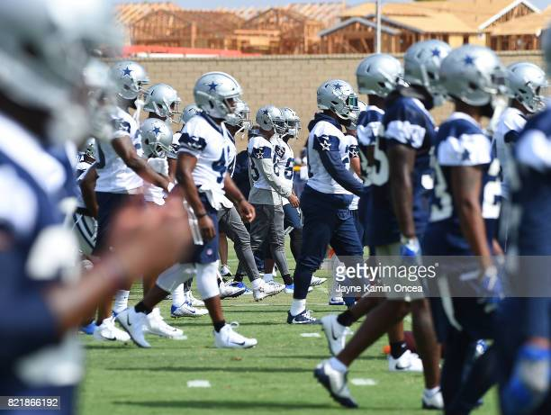 Dallas Cowboys players stretch during training camp on July 24 2017 in Oxnard California