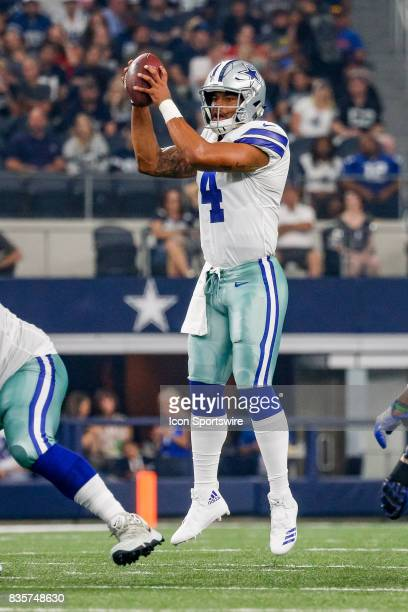 Dallas Cowboys quarterback Dak Prescott handles a high snap during the NFL preseason game between the Indianapolis Colts and Dallas Cowboys at ATT...