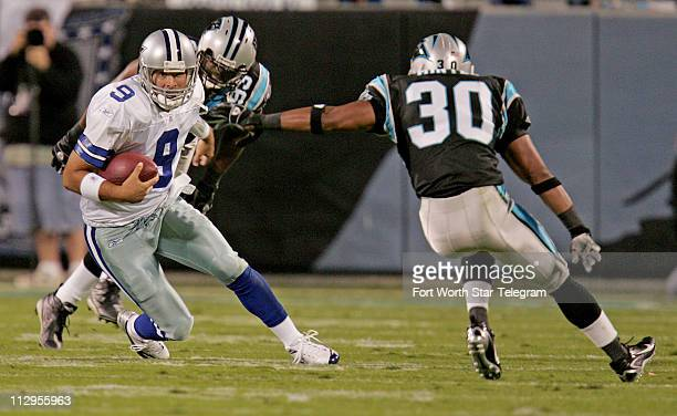 Dallas Cowboys quarterback Tony Romo scrambles down the field in the first quarter as the Carolina Panthers are in pursuit at Bank of America Stadium...