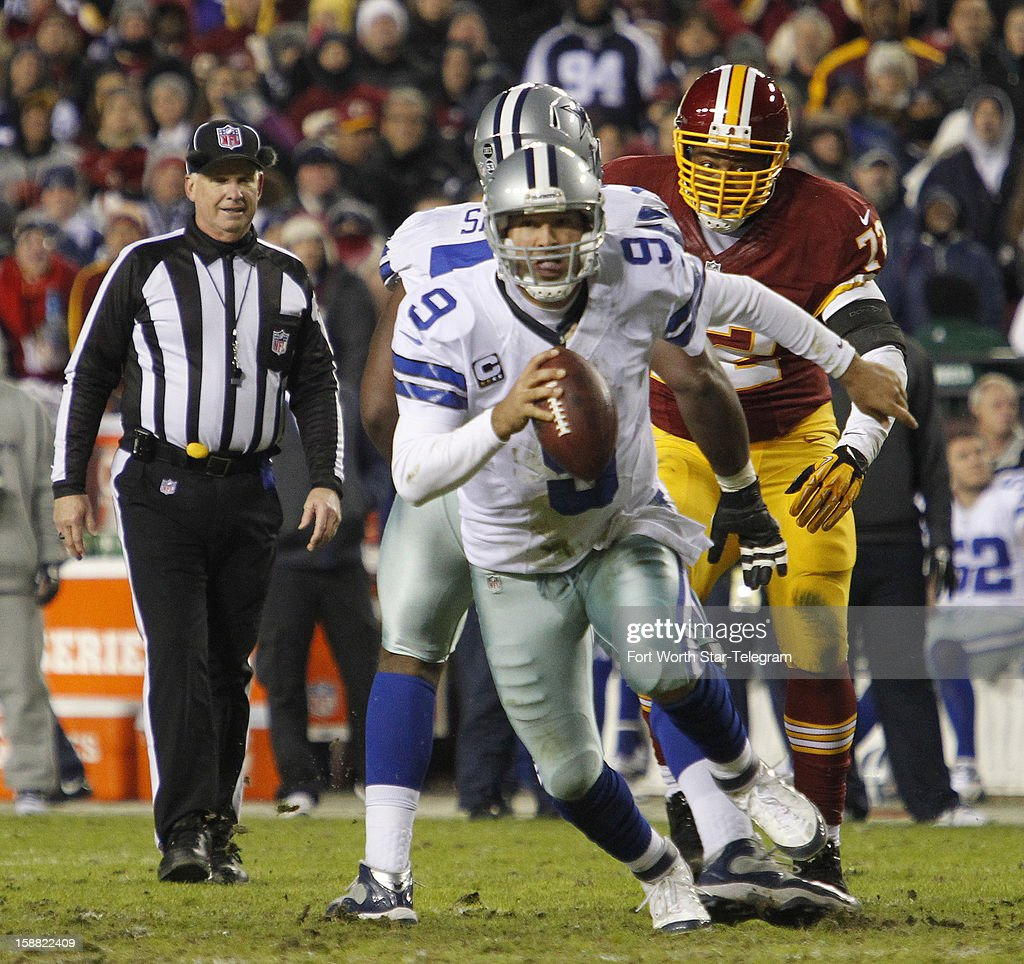 Dallas Cowboys quarterback Tony Romo (9) scrambles under pressure, hitting Jason Witten in the end zone in the second quarter with a 9-yard pass for the Cowboys first touchdown as the Washington Redskins faced the Dallas Cowboys, Sunday, December 30, 2012 in Landover, Maryland.