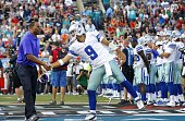 Dallas Cowboys quarterback Tony Romo shakes hands with Hall of Fame receiver Chris Carter before the Hall of Fame Game against the Miami Dolphins at...