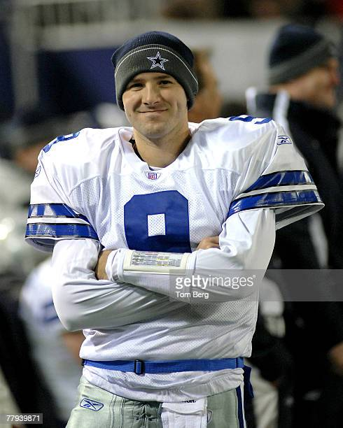 Dallas Cowboys quarterback Tony Romo smiling on the sidelines as he watches his defense on the field against New York Giants offense during the...