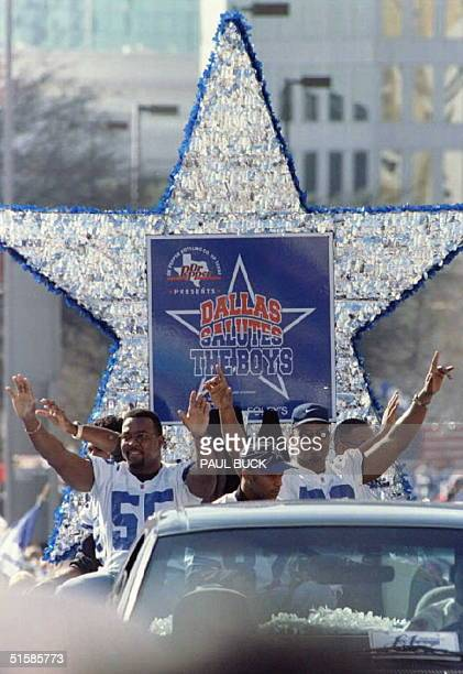 Dallas Cowboys Robert Jones and Darrin Smith wave to the crowd from a blue and silver star float during the Cowboys' Super Bowl XXX victory parade...