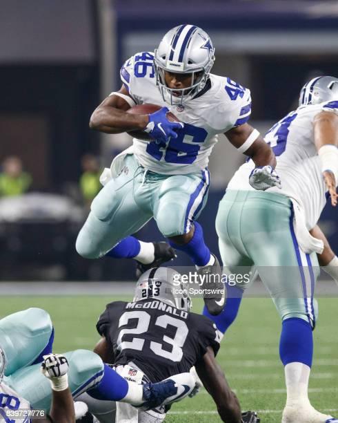 Dallas Cowboys running back Alfred Morris hurdles Oakland Raiders cornerback Dexter McDonald during the NFL preseason game between the Dallas Cowboys...