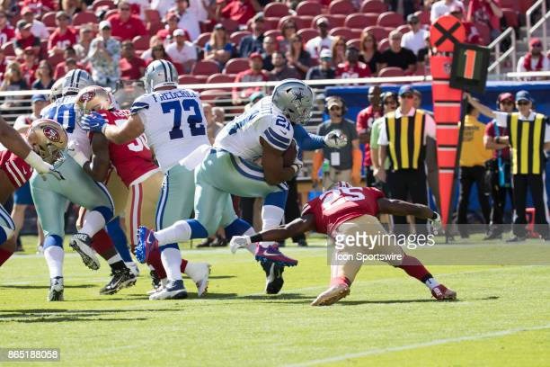 Dallas Cowboys running back Ezekiel Elliott is tackled by San Francisco 49ers free safety Jimmie Ward during the first half of the regular season...