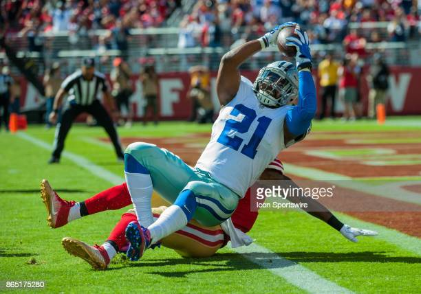 Dallas Cowboys running back Ezekiel Elliott reaches over the goal line during the regular season game between the San Francisco 49ers and the Dallas...