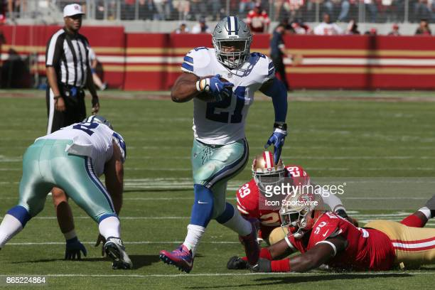 Dallas Cowboys running back Ezekiel Elliott runs the ball against the San Francisco 49ers during an NFL game on October 22 2017 at Levi's Stadium in...