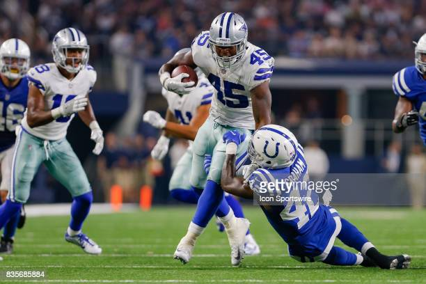Dallas Cowboys running back Rod Smith runs through a tackle by Indianapolis Colts defensive back Tyson Graham during the NFL preseason game between...