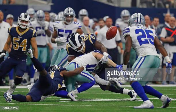 Dallas Cowboys special teams Ryan Switzer loses the ball on a kick return recovered by Los Angeles Rams cornerback Troy Hill in the second quarter as...