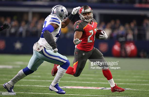 Dallas Cowboys strong safety Barry Church chases Tampa Bay Buccaneers running back Doug Martin on Sunday Dec 18 2016 at ATT Stadium in Arlington Texas