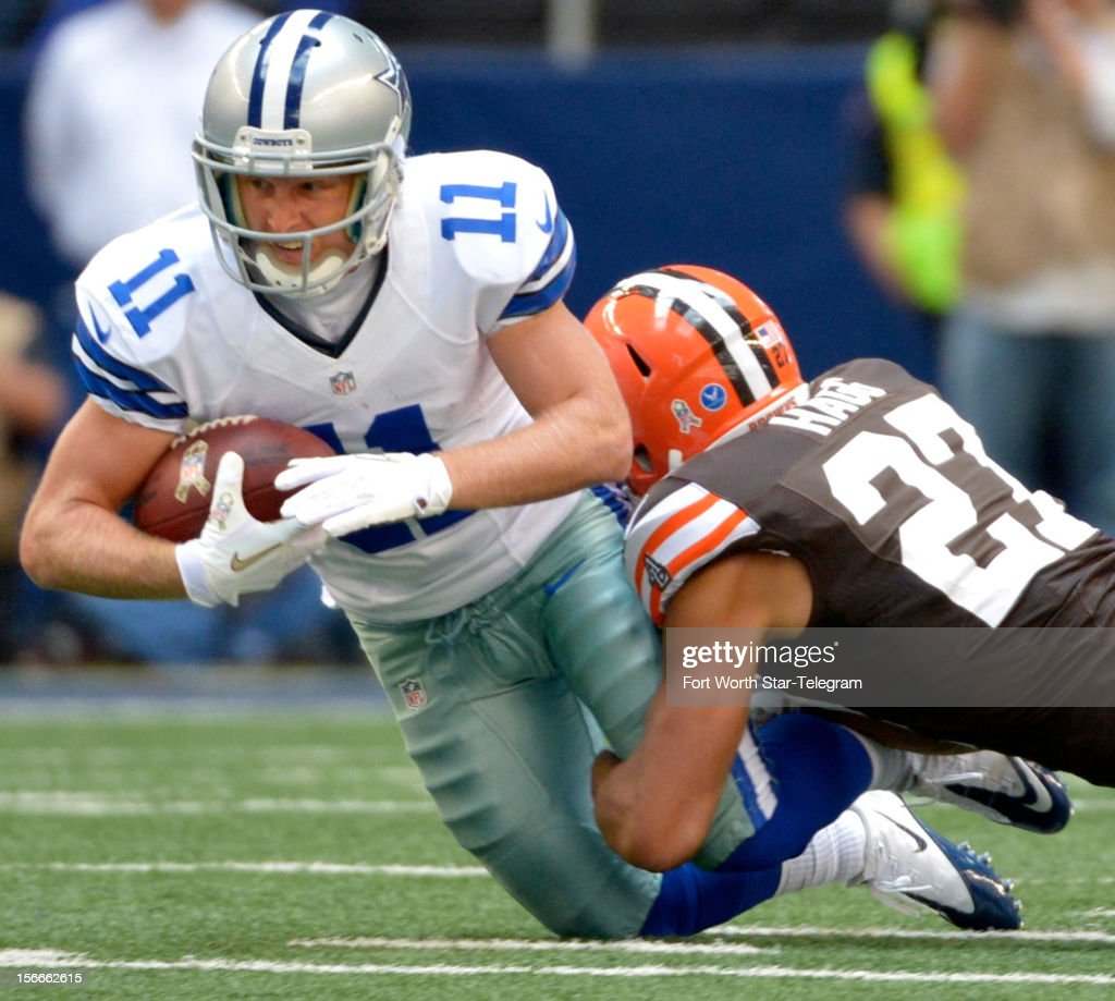 Dallas Cowboys wide receiver Cole Beasley (11) is tackled by Cleveland Browns free safety Eric Hagg (27) after picking up 8 yards during the second quarter at Cowboys Stadium Sunday, November 18, 2012, in Arlington, Texas.