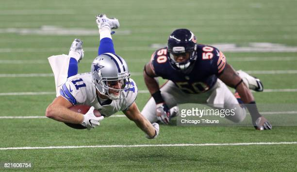 Dallas Cowboys wide receiver Cole Beasley leaps for extra yardage as Chicago Bears inside linebacker Jerrell Freeman watches in the second quarter of...