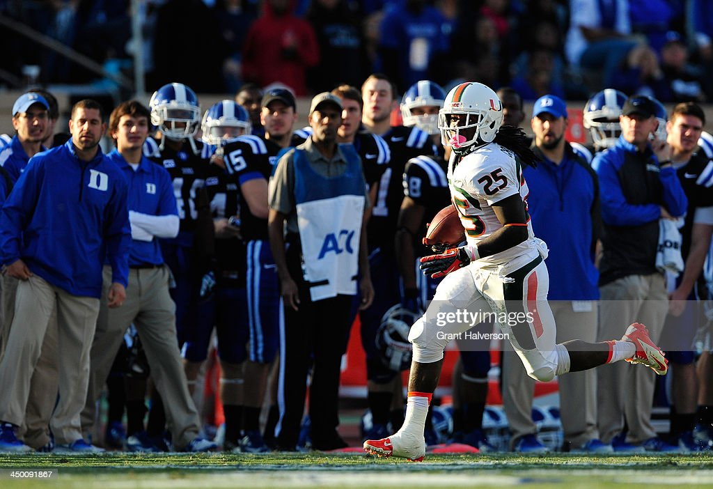 Dallas Crawford #25 of the Miami Hurricanes runs for a long gain against the Duke Blue Devils during play at Wallace Wade Stadium on November 16, 2013 in Durham, North Carolina.