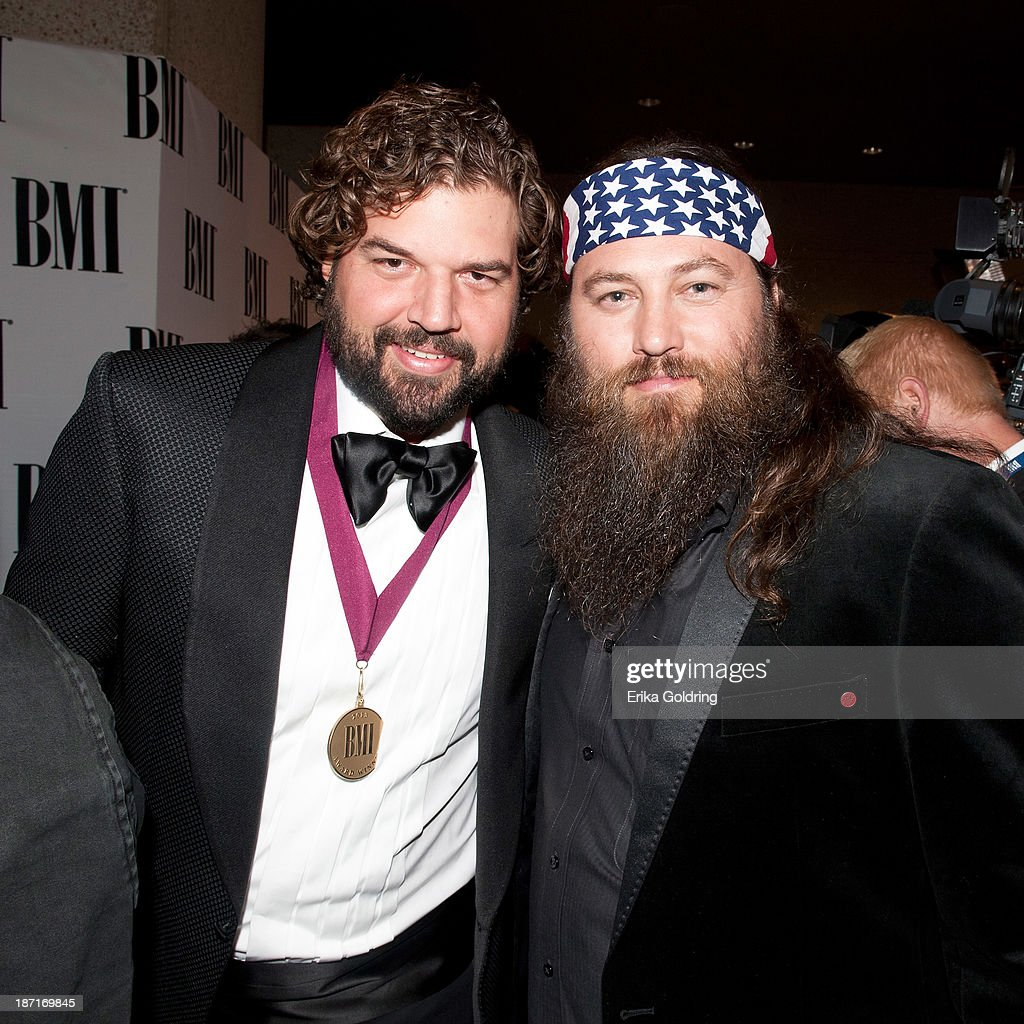 Dallas Davidson and Duck Dynasty's Willie Robertson attend the 61st annual BMI Country awards on November 5, 2013 in Nashville, Tennessee.