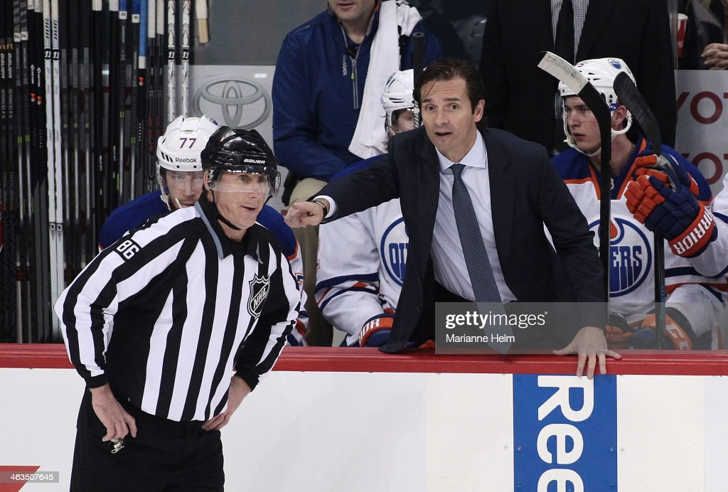<a gi-track='captionPersonalityLinkClicked' href=/galleries/search?phrase=Dallas+Eakins&family=editorial&specificpeople=714367 ng-click='$event.stopPropagation()'>Dallas Eakins</a>, head coach of the Edmonton Oilers, tries to make his point known to linesman Brad Lazarowich #86 in first period action in an NHL game against the Winnipeg Jets at the MTS Centre on January 18, 2014 in Winnipeg, Manitoba, Canada.