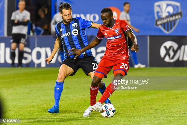 Dallas forward Roland Lamah and Montreal Impact forward Matteo Mancosu battling for the ball during the FC Dallas versus the Montreal Impact game on...