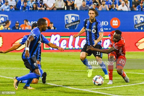 Dallas forward Roland Lamah trying hard to go around Montreal Impact midfielder Marco Donadel during the FC Dallas versus the Montreal Impact game on...