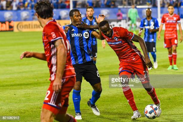 Dallas forward Roland Lamah while controlling the ball puts his hand on Montreal Impact midfielder Patrice Bernier face during the FC Dallas versus...