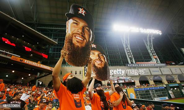 Dallas Keuchel fans cheer in left field during the fifth inning of the game between the Houston Astros and the Tampa Bay Rays at Minute Maid Park on...