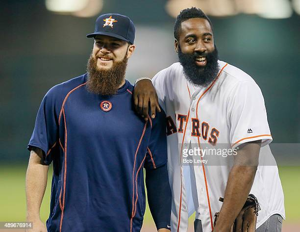 Dallas Keuchel of the Houston Astros and James Harden of the Houston Rockets share a laugh after Harden threw out the first pitch at Minute Maid Park...
