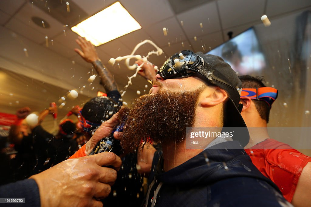 Dallas Keuchel #60 of the Houston Astros celebrate with his teammates in the locker room after defeating the New York Yankees in the American League Wild Card Game at Yankee Stadium on October 6, 2015 in New York City. The Astros defeated the Yankees with a score of 3 to 0.