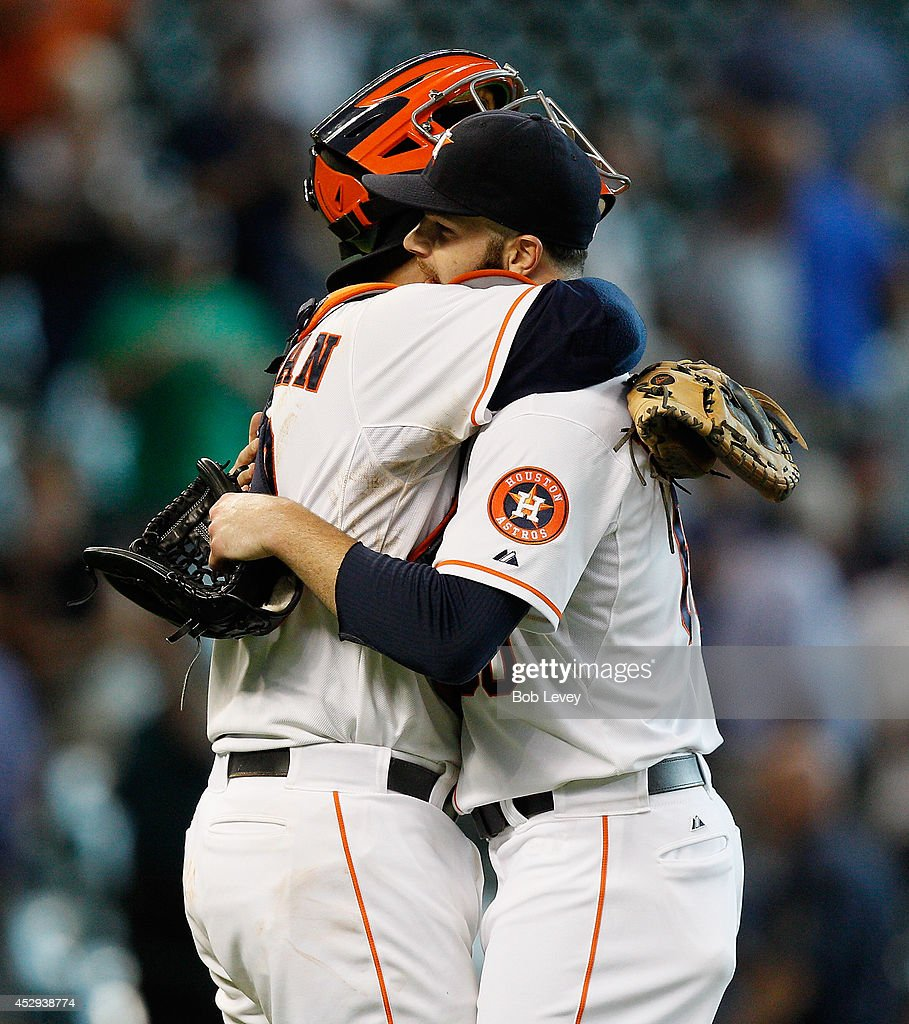 <a gi-track='captionPersonalityLinkClicked' href=/galleries/search?phrase=Dallas+Keuchel&family=editorial&specificpeople=5928400 ng-click='$event.stopPropagation()'>Dallas Keuchel</a> #60 of the Houston Astros hugs catcher <a gi-track='captionPersonalityLinkClicked' href=/galleries/search?phrase=Carlos+Corporan&family=editorial&specificpeople=5716887 ng-click='$event.stopPropagation()'>Carlos Corporan</a> #22 after the final out at Minute Maid Park on July 30, 2014 in Houston, Texas.