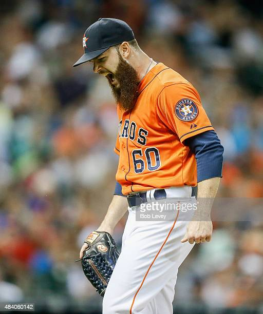 Dallas Keuchel of the Houston Astros lets out a yell after getting out of the sixth inning against the Detroit Tigers at Minute Maid Park on August...