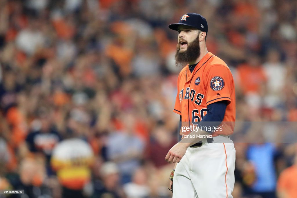 Dallas Keuchel #60 of the Houston Astros reacts after striking out Aaron Judge #99 of the New York Yankees to end the top of the third inning during game one of the American League Championship Series at Minute Maid Park on October 13, 2017 in Houston, Texas.