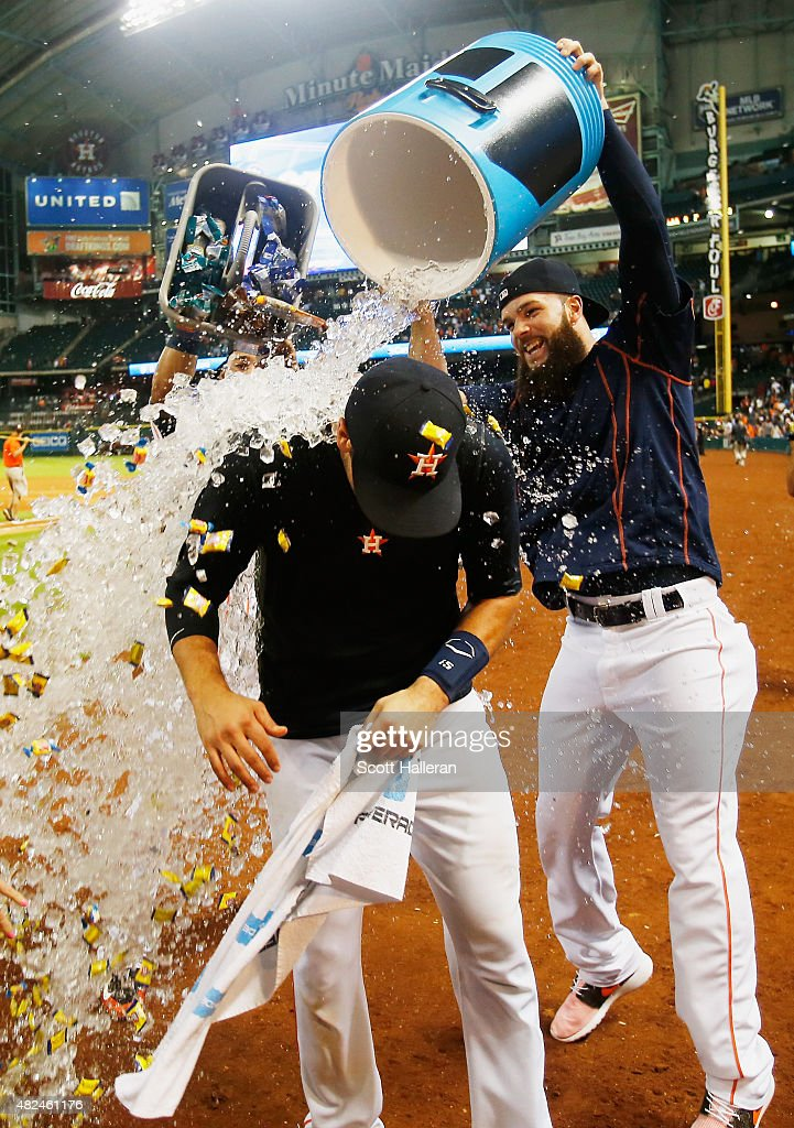 Dallas Keuchel #60 of the Houston Astros showers his teammate Jason Castro #15 with water after Castro hit a three-run home run in the ninth inning to end the game and defeat the Los Angeles Angels of Anaheim 3-0 during their game at Minute Maid Park on July 30, 2015 in Houston, Texas.