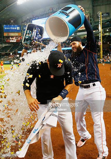 Dallas Keuchel of the Houston Astros showers his teammate Jason Castro with water after Castro hit a threerun home run in the ninth inning to end the...